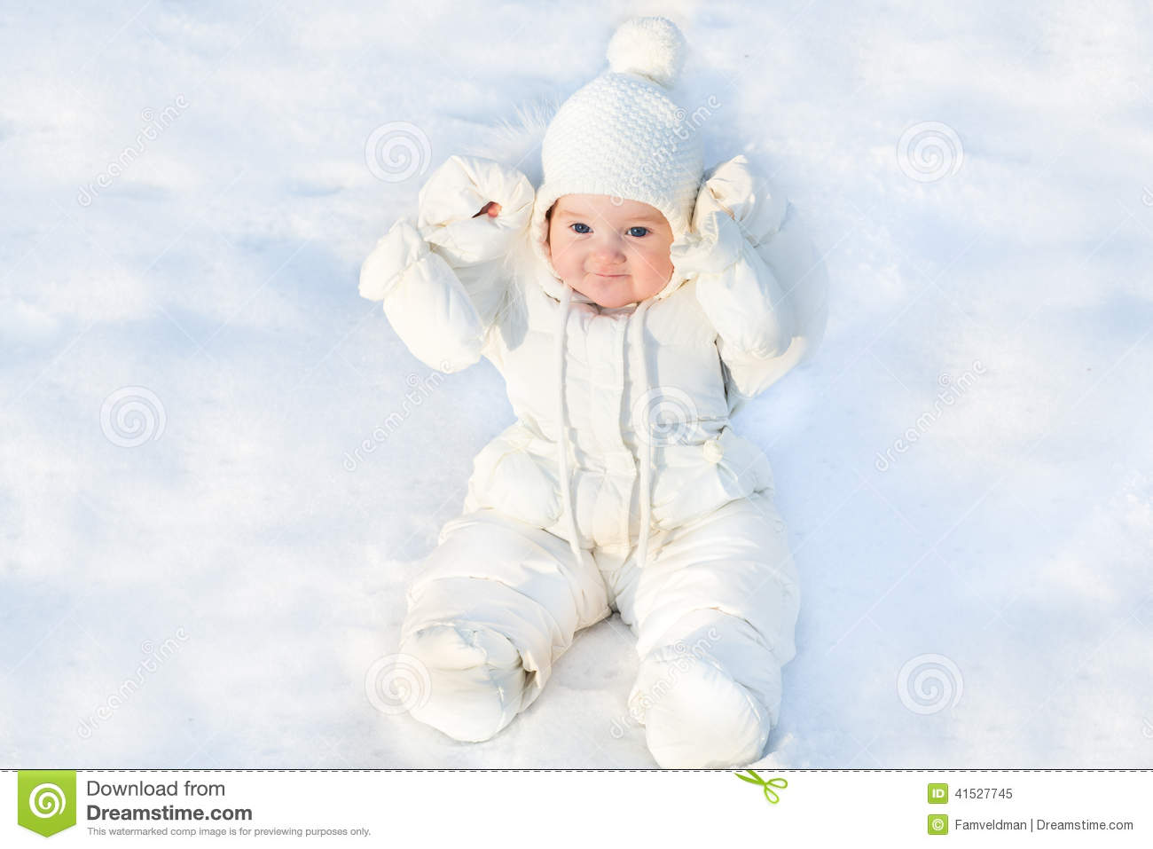 Funny Little Baby Sitting In Fresh Snow Stock Photo