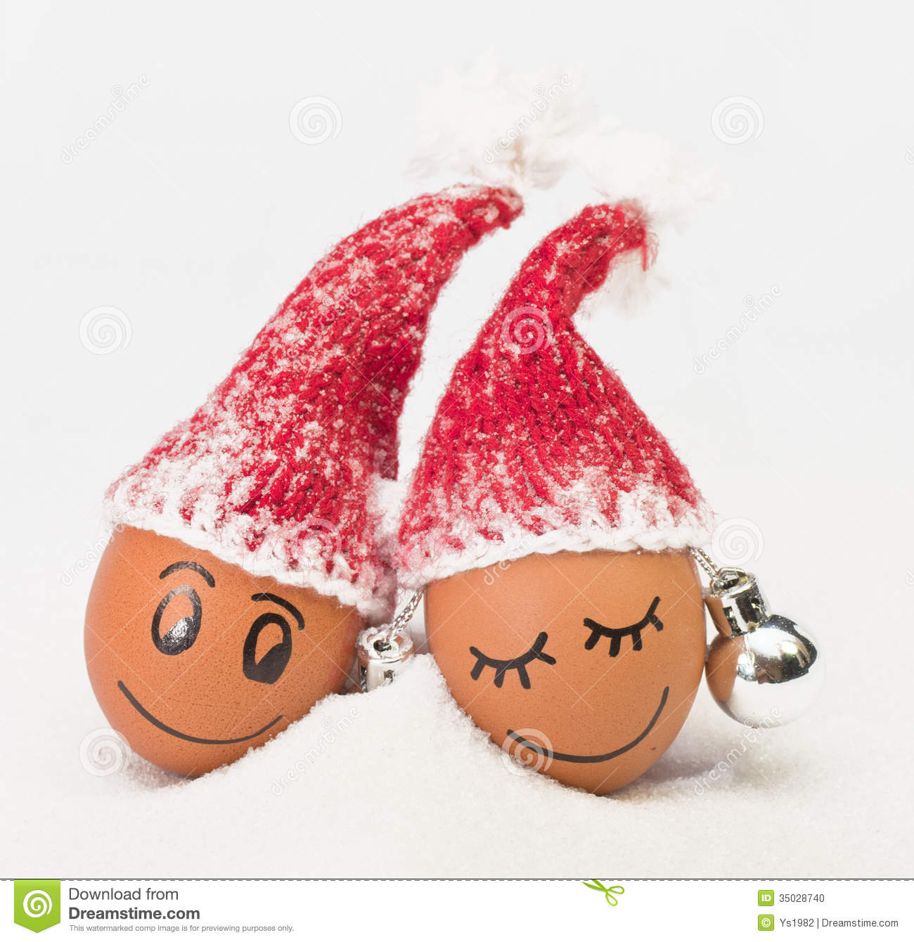 Funny lovely eggs in winter santa hats stock photo image
