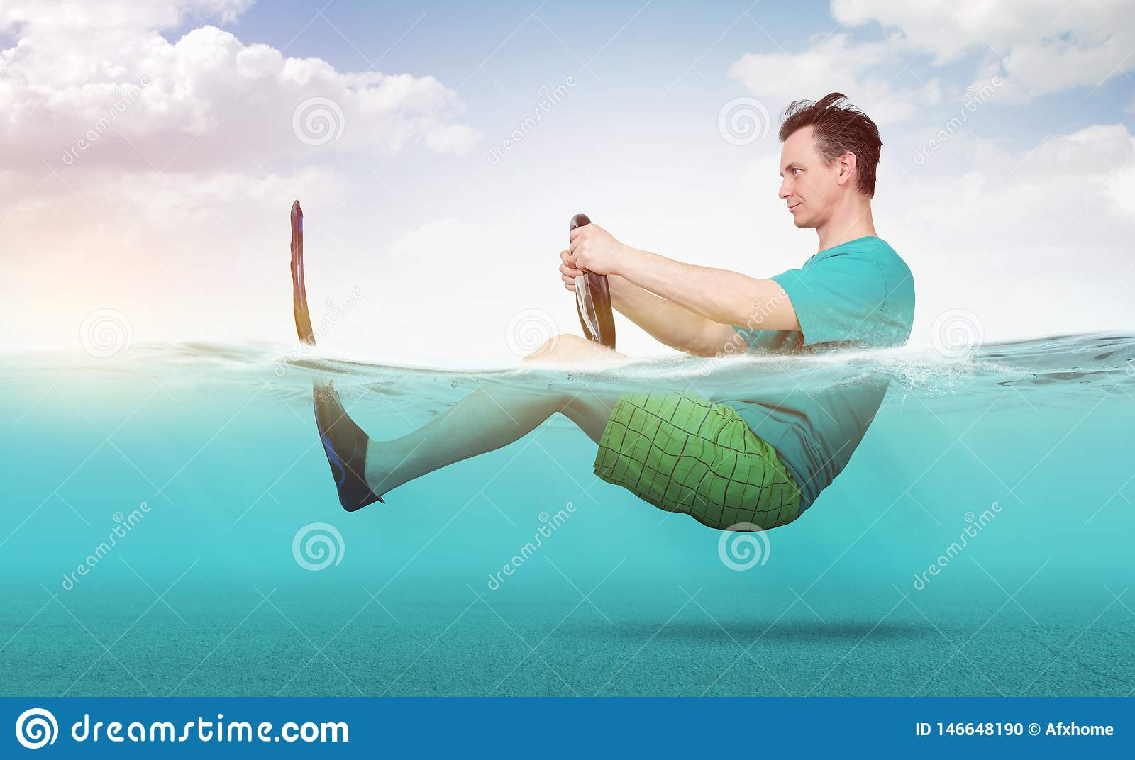 Funny man in shorts, T-shirt and flippers rides on the sea with a car steering wheel. Concept of going on vacation