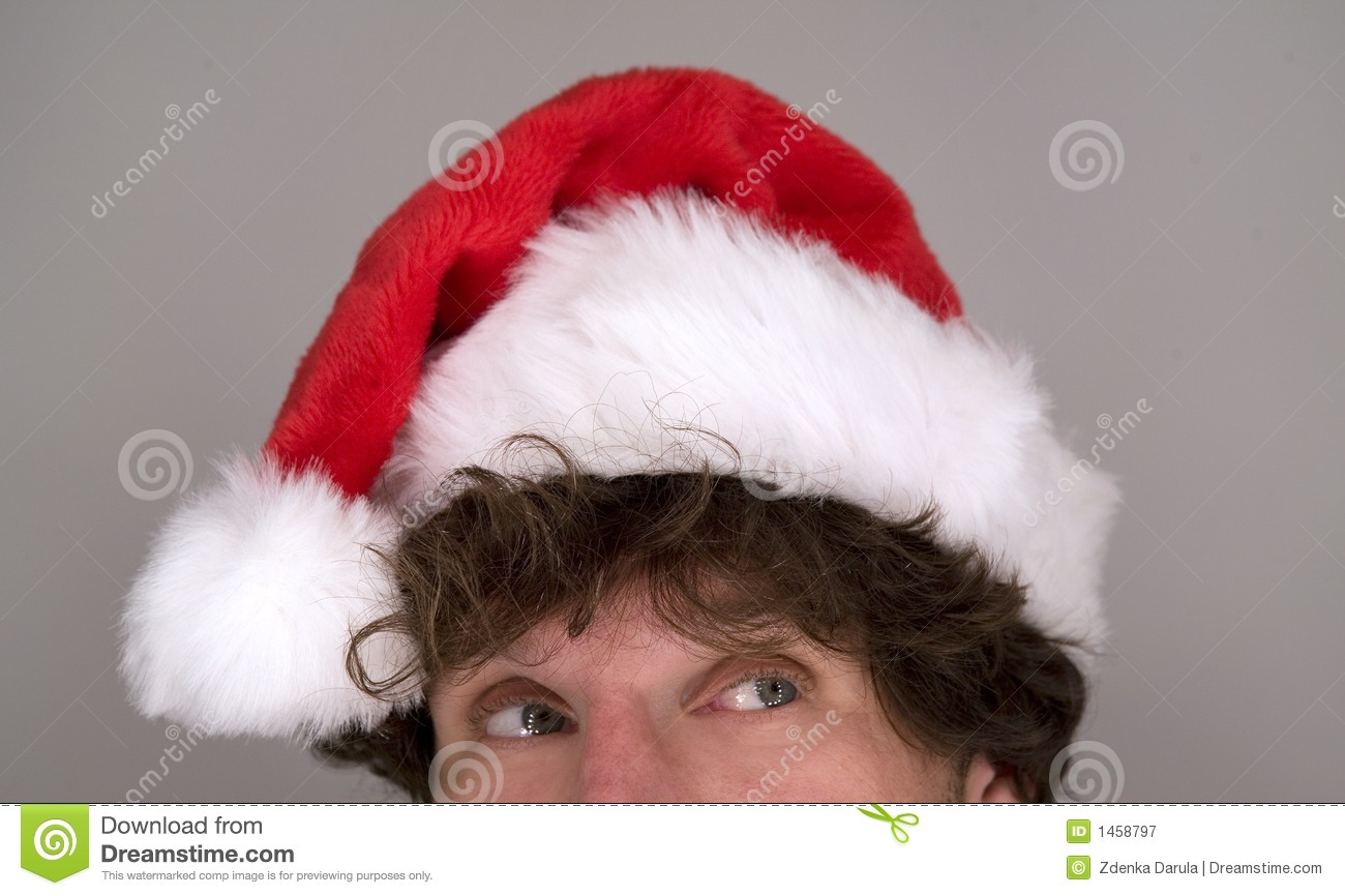 Funny man wearing santa hat royalty free stock photography
