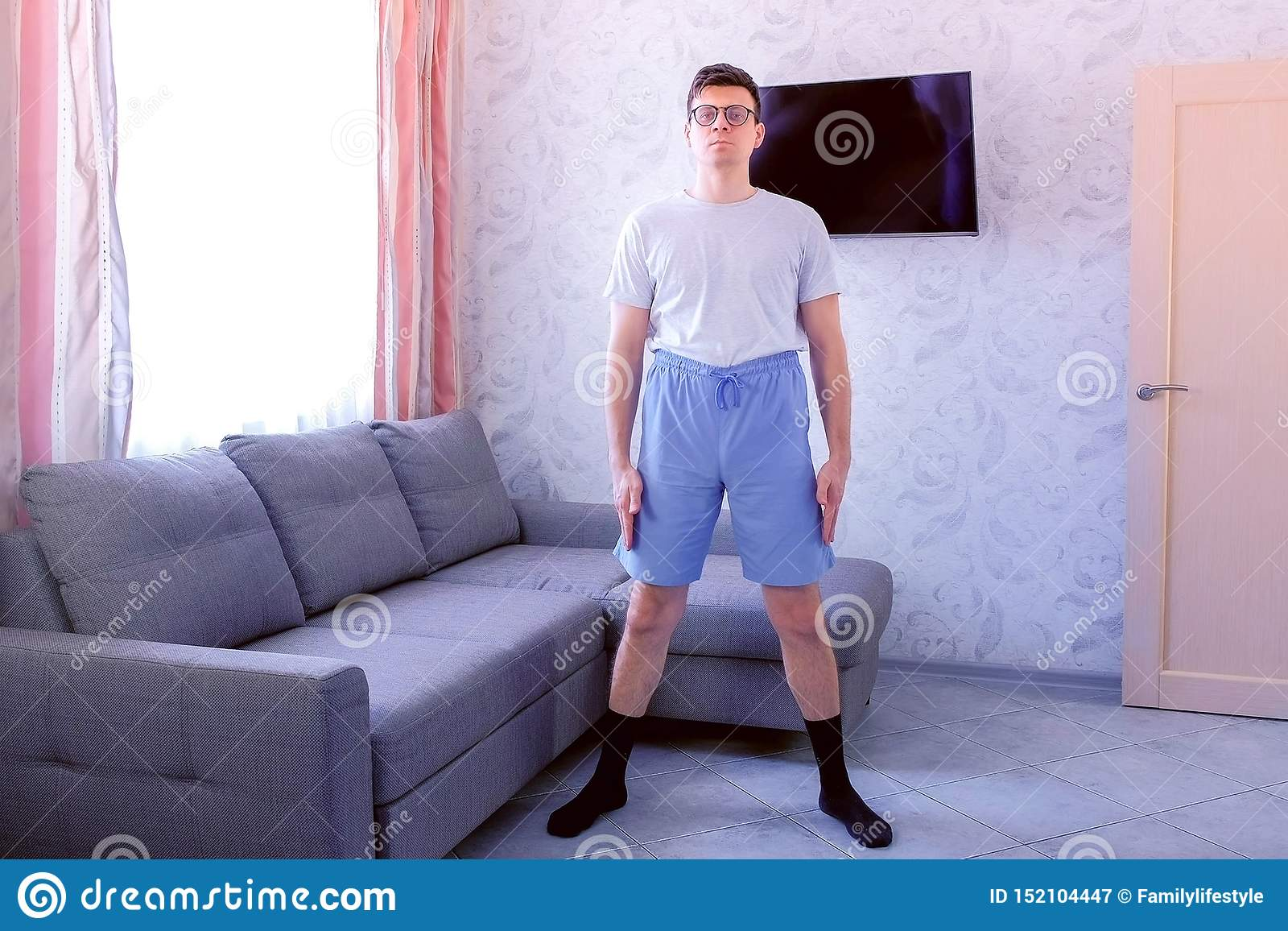 Funny Nerd Man Is Doing Fitness Exercises Pelvis Rotations At Home Sport Humor Concept Stock Image Image Of Socks Exercise 152104447