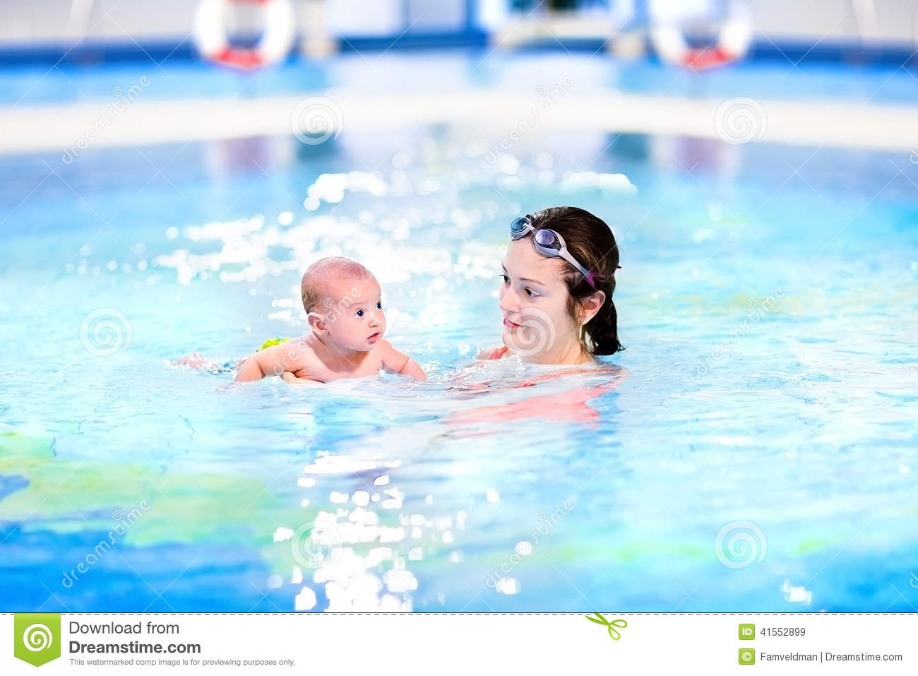 Funny newborn baby boy swimming with his mother