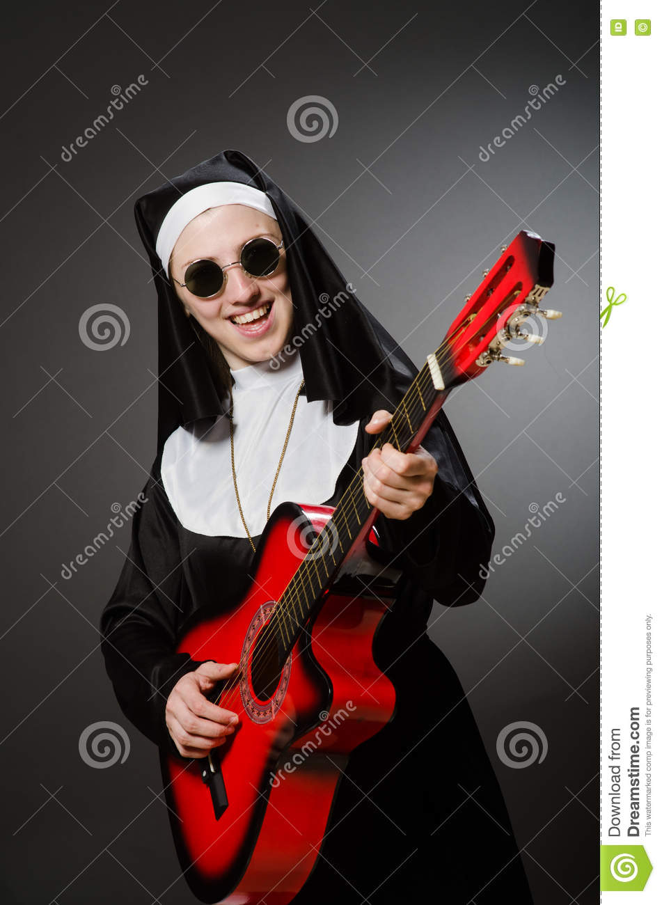 The funny nun with red guitar playing