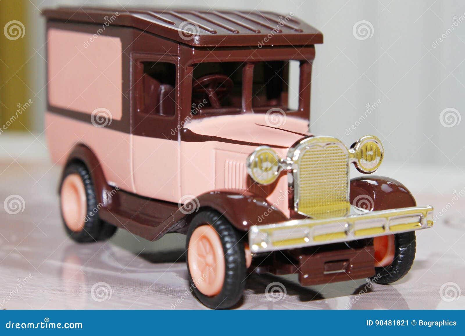 Funny pink vintage toy car