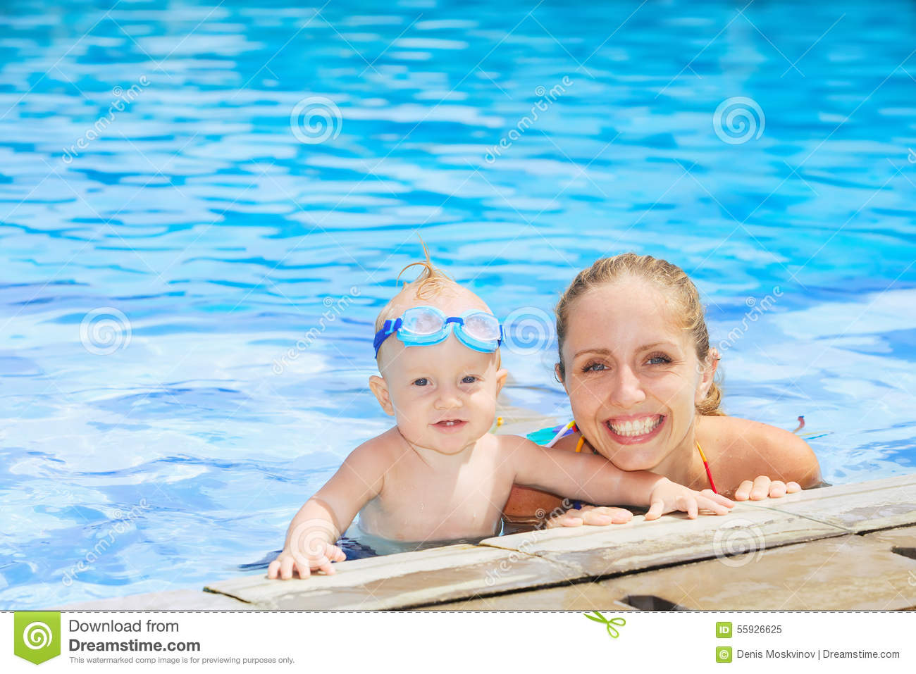Funny portrait of baby boy swimming with mother in pool