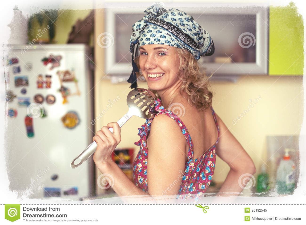 Funny portrait of the housewife in the kitchen