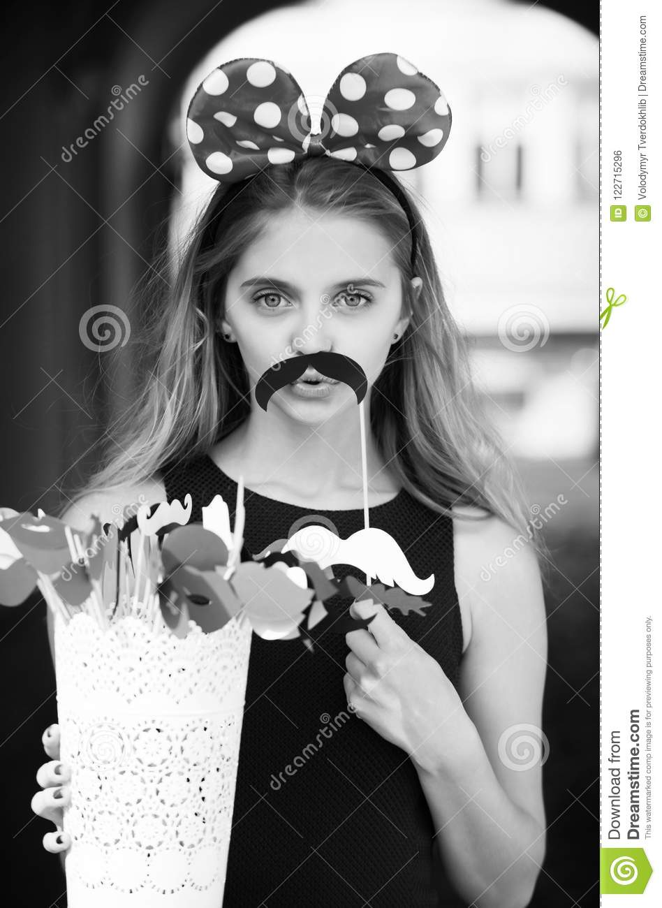 Funny pretty girl with cute mouse ears and black moustache