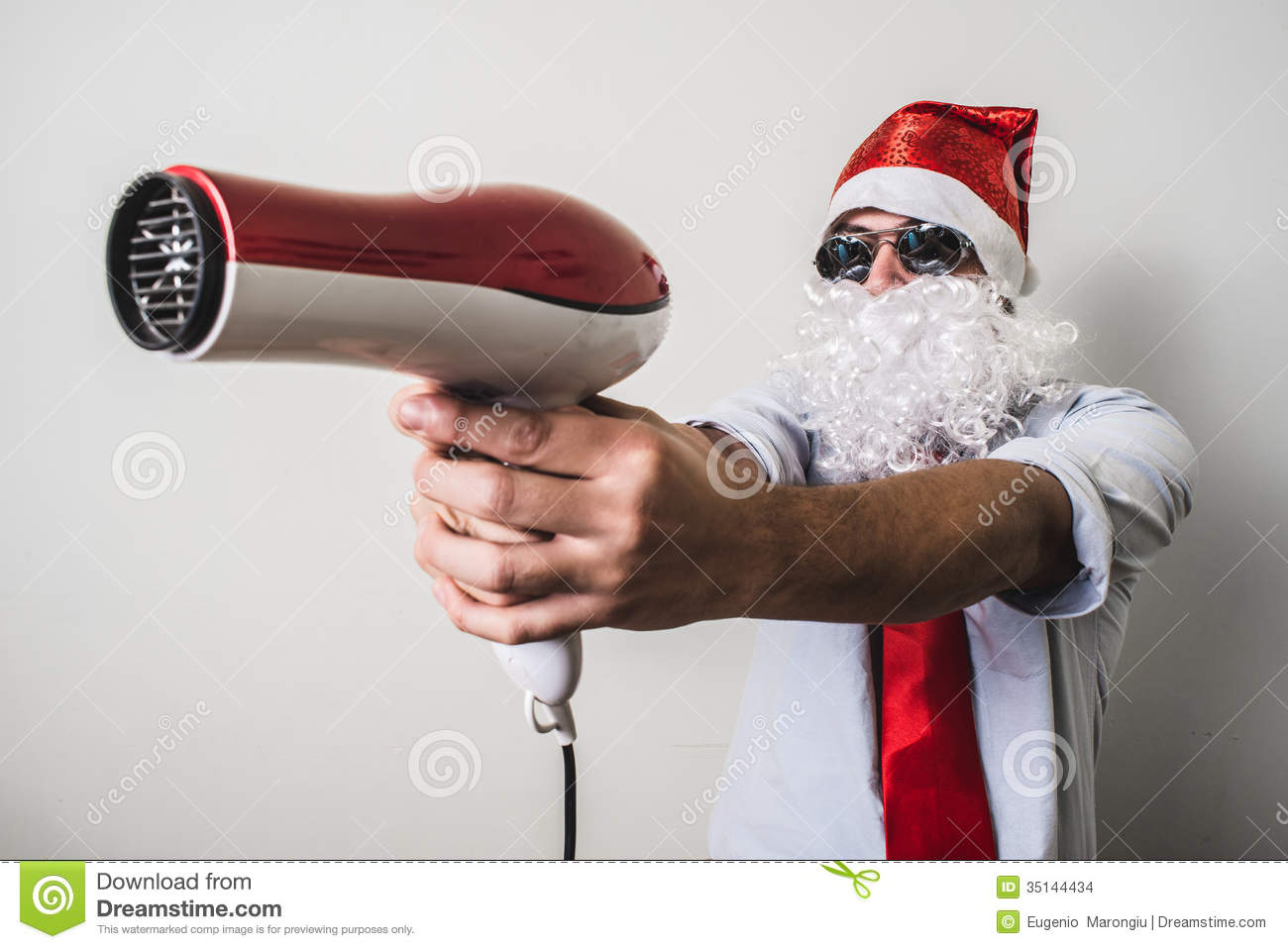 Funny santa claus babbo natale with hairdryer