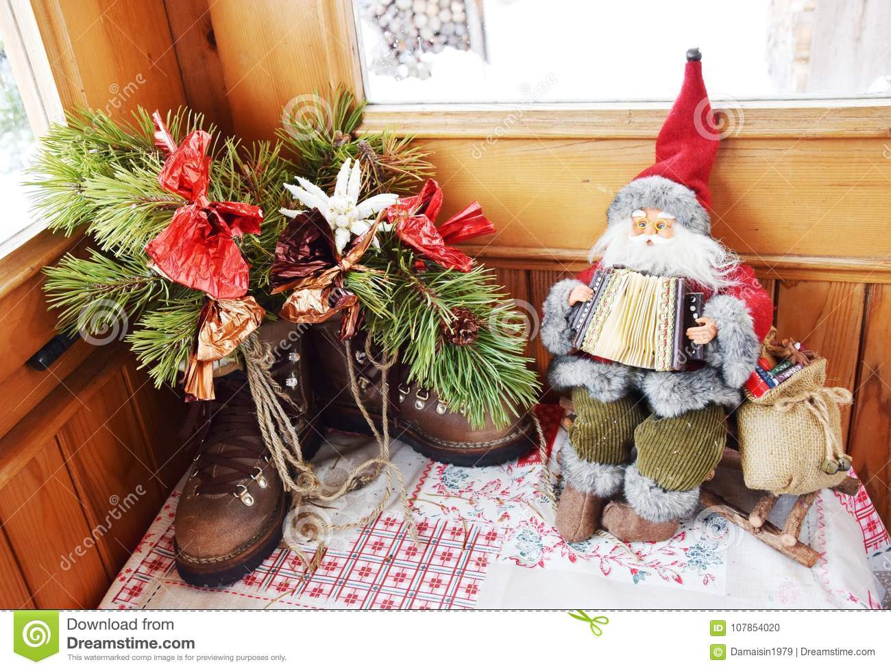 Santa Claus toy, shoose and snow in Dolomity mountains, winter image