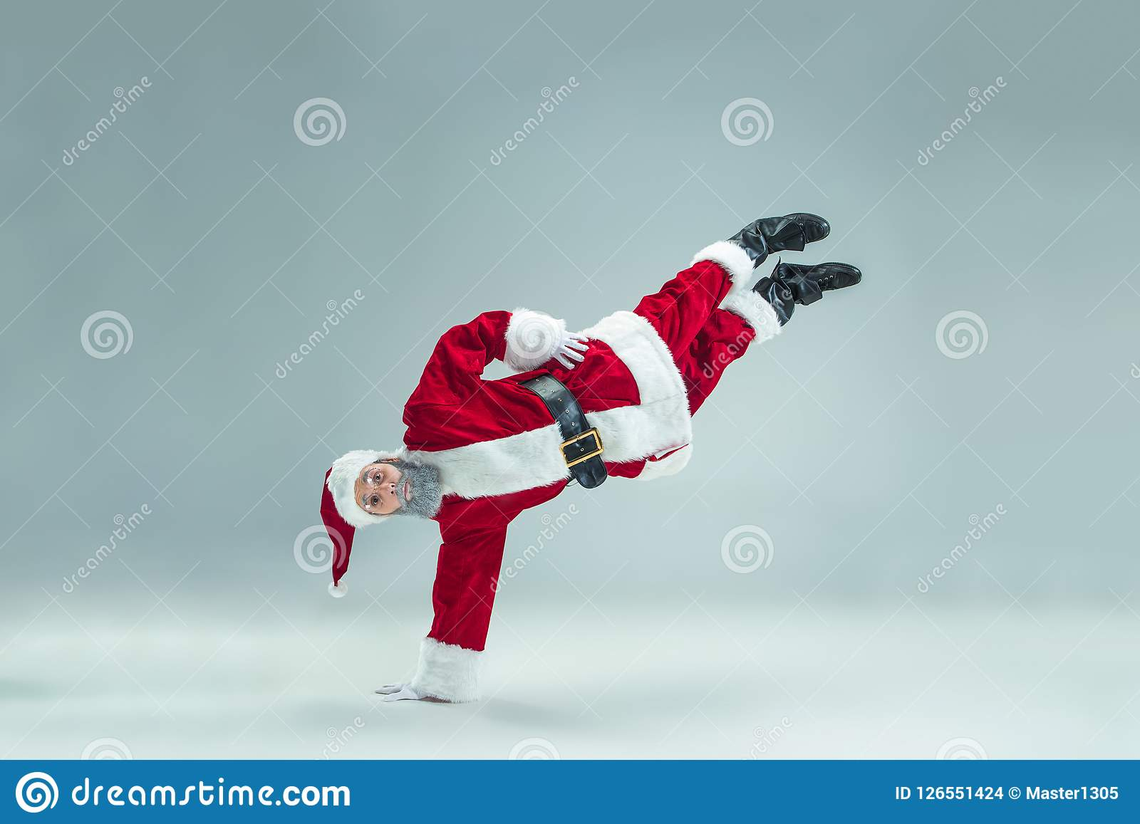 Funny guy in christmas hat. New Year Holiday. Christmas, x-mas, winter, gifts concept.