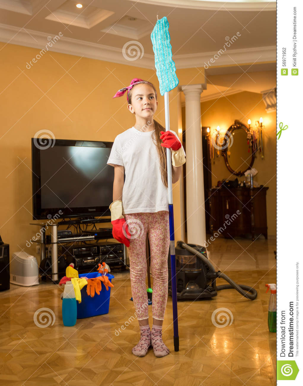 Funny Girl Sweeping The Floor Royalty Free Stock Photo