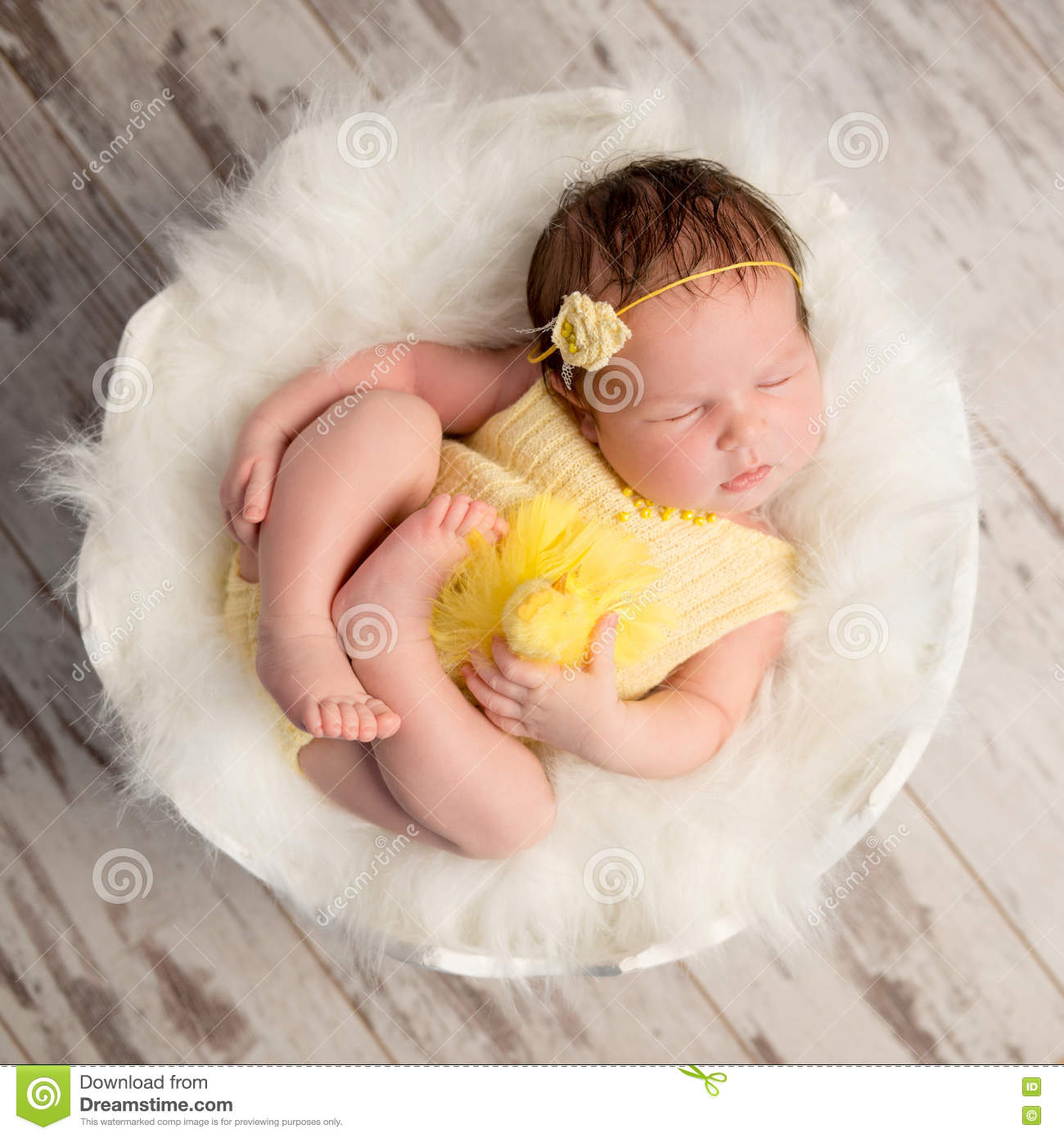 52cd3aa13 Funny Sleeping Baby In Yellow Romper On Round Cot Stock Photo ...