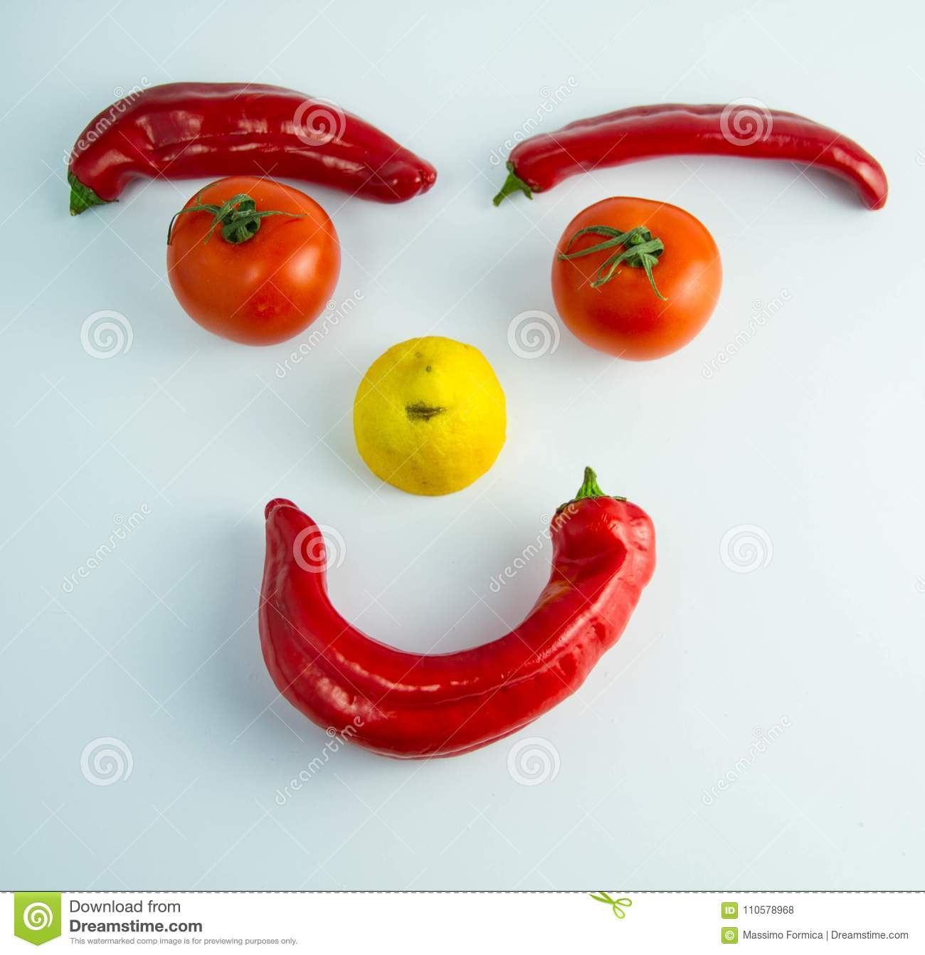 A funny smiling emoticon made of vegetables
