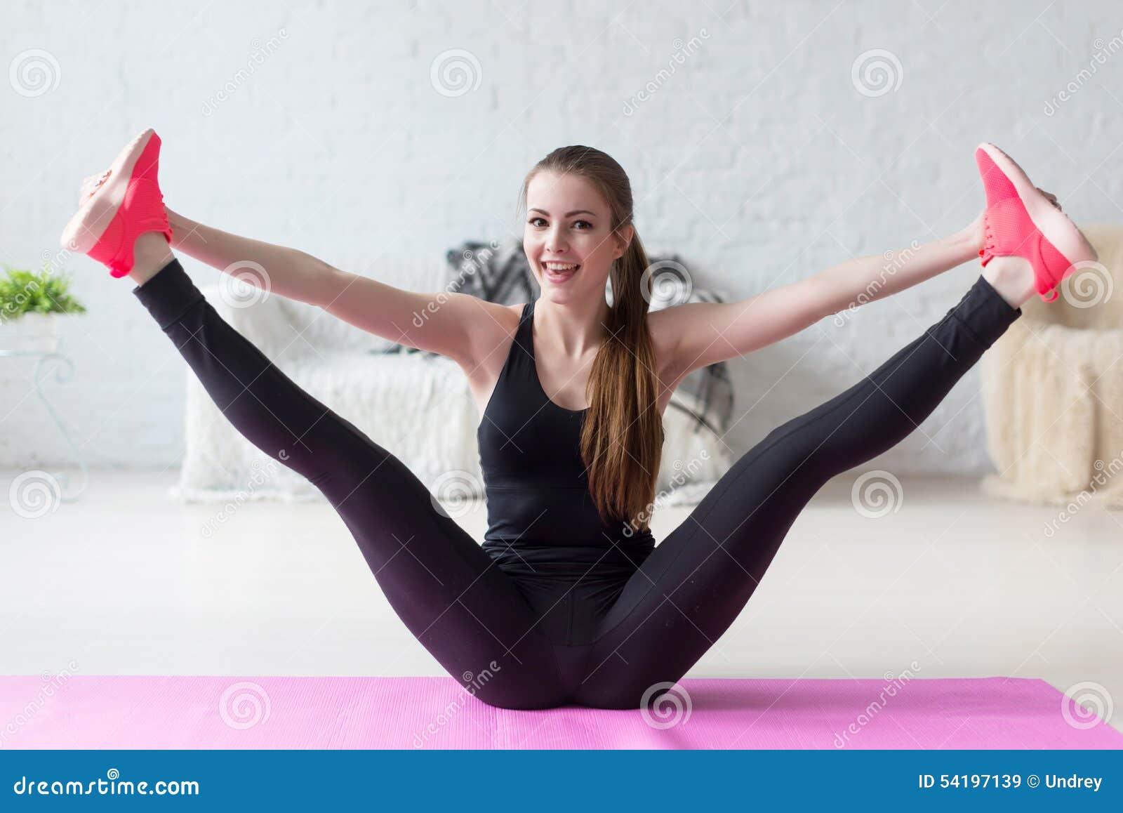 Funny Smiling Girl Holding Legs Apart Doing Stock Photo