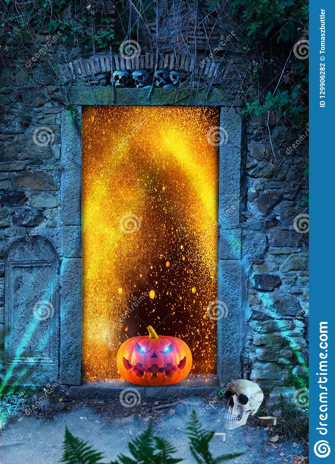 Funny spooky halloween pumpkin with spider, skulls and candles in front of the hell`s door..