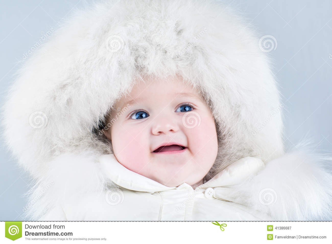 ad12f990319f Funny Sweet Baby Girl Wearing A Big Fur Hat Stock Image - Image of ...