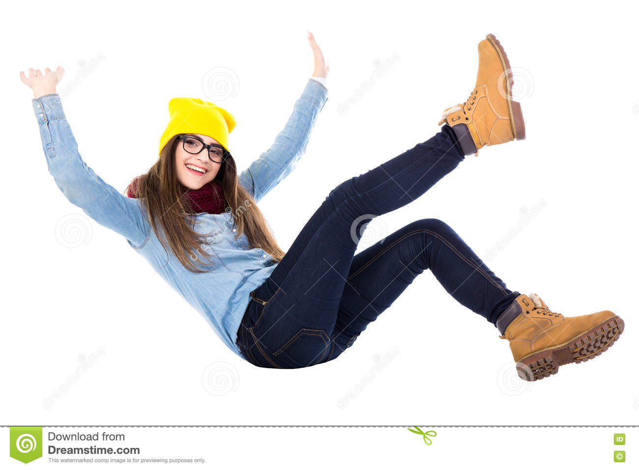 1109e420db6 Funny teenage girl falling down in winter clothes isolated on white  background