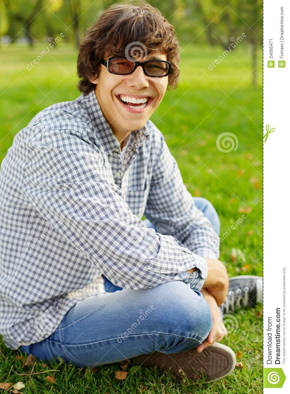 Funny teenager laughs in park