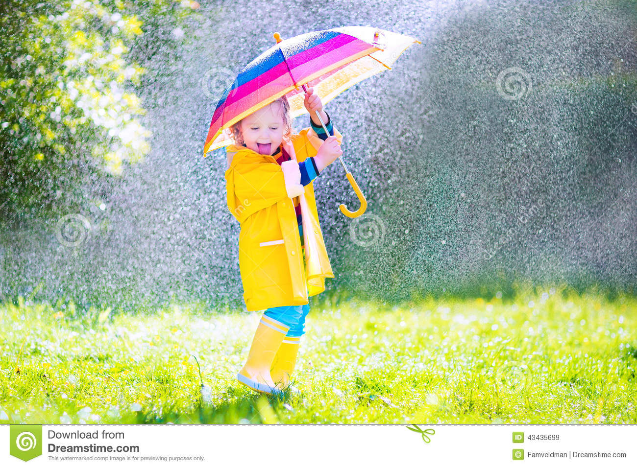 Funny Toddler With Umbrella Playing In The Rain Stock