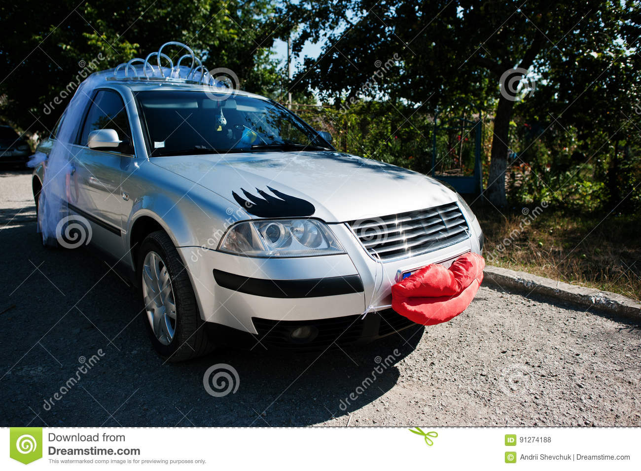 Funny Wedding Car With Lips And Eyelashes For Bride Stock Photo