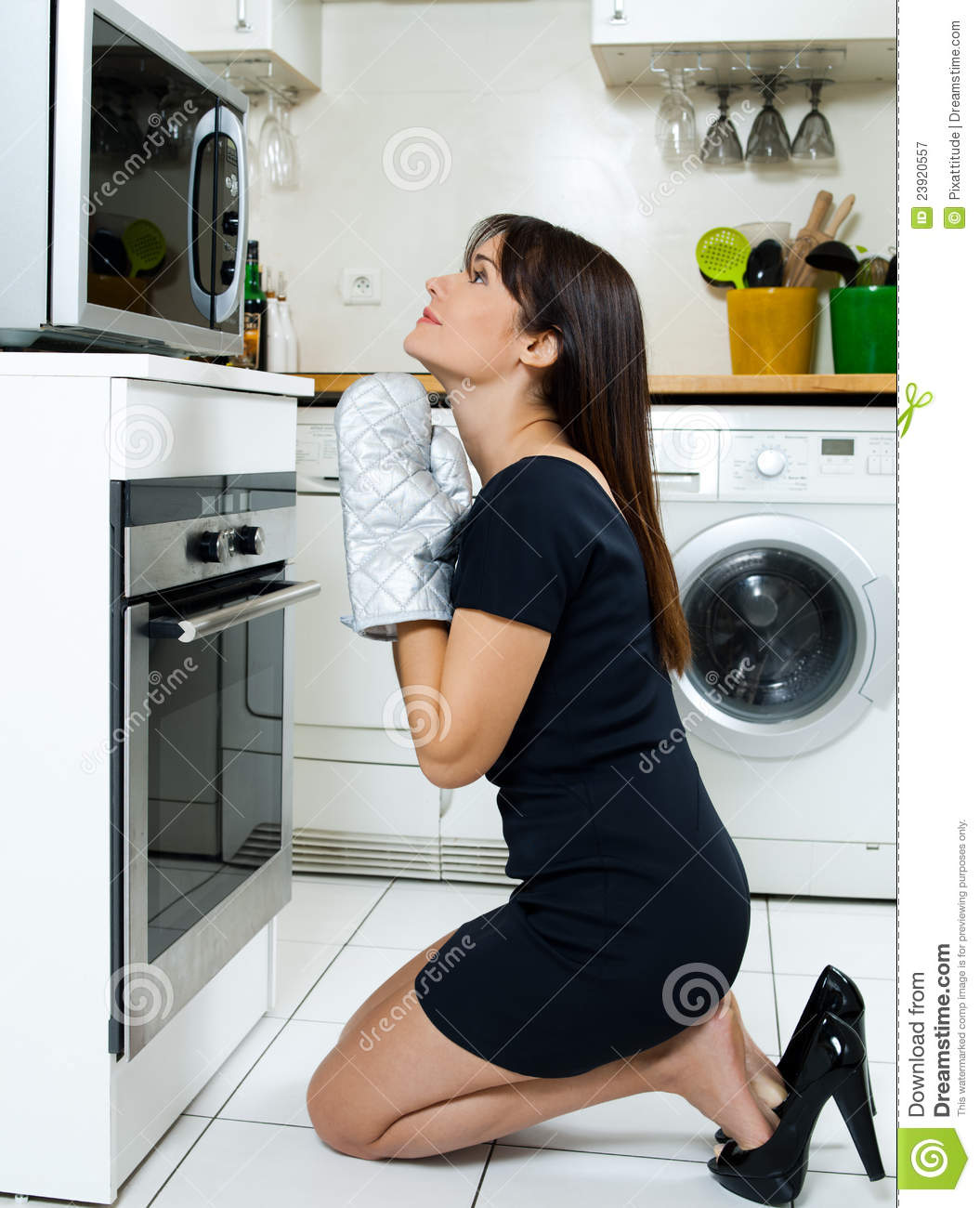 Black Woman Cooking In Kitchen