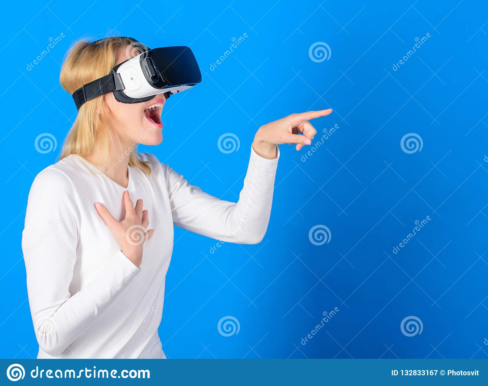 Funny woman experiencing 3D gadget technology - close up. Excited smiling businesswoman wearing virtual reality glasses