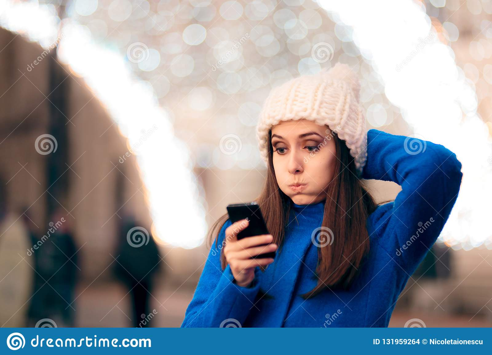 Girl Receiving Inappropriate Text Messages On Christmas Time Stock ...