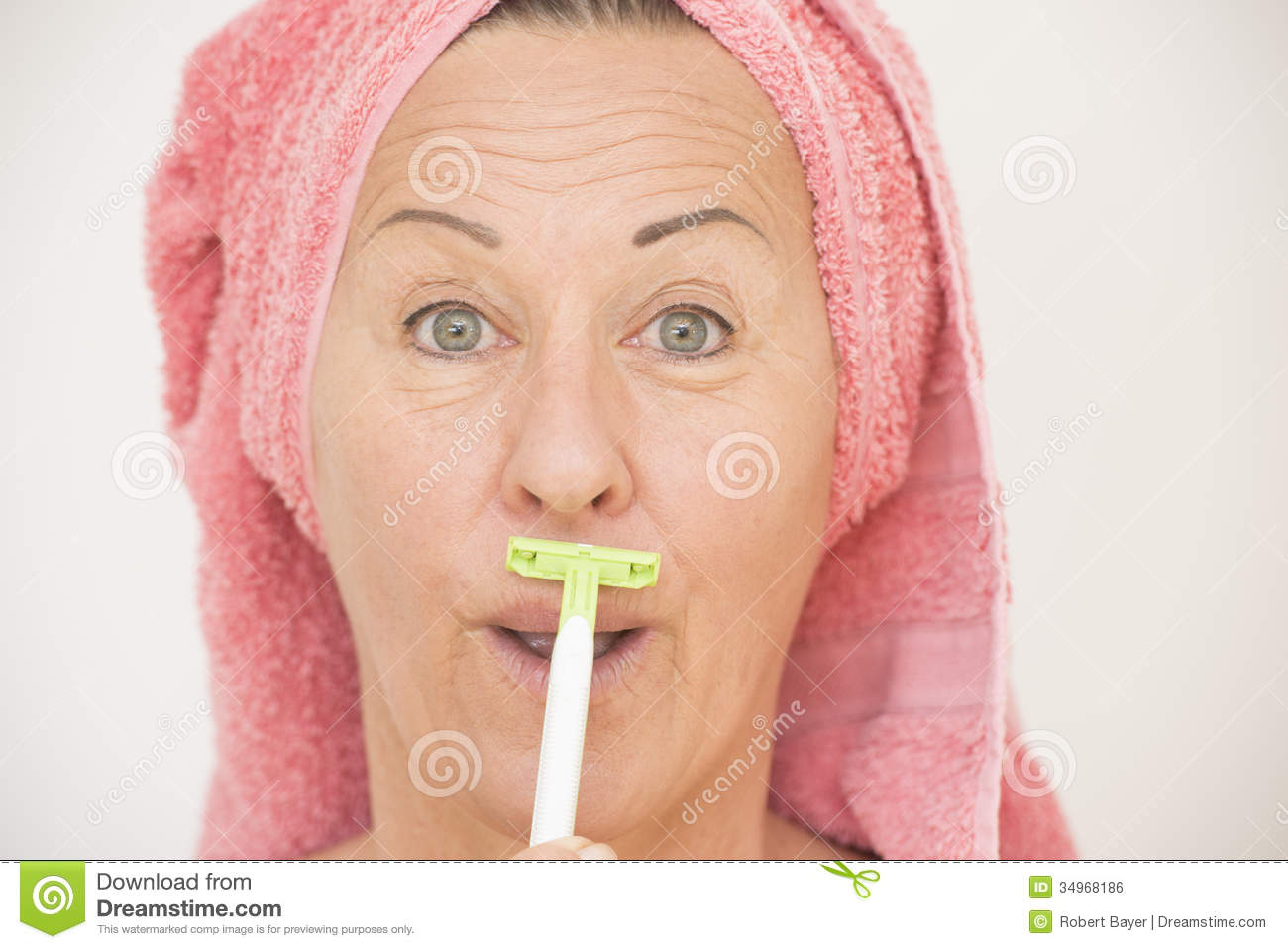 Attractive Funny Mature Woman With Towel Around Head Shaving Her Face