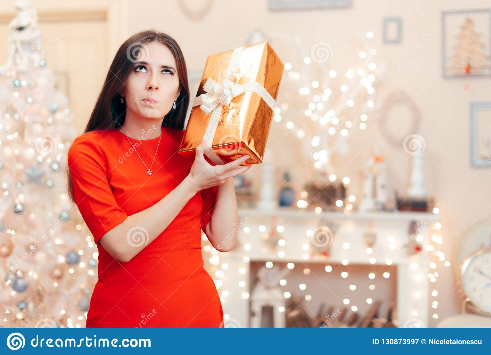 Curious Woman Checking Christmas Gift in the Morning