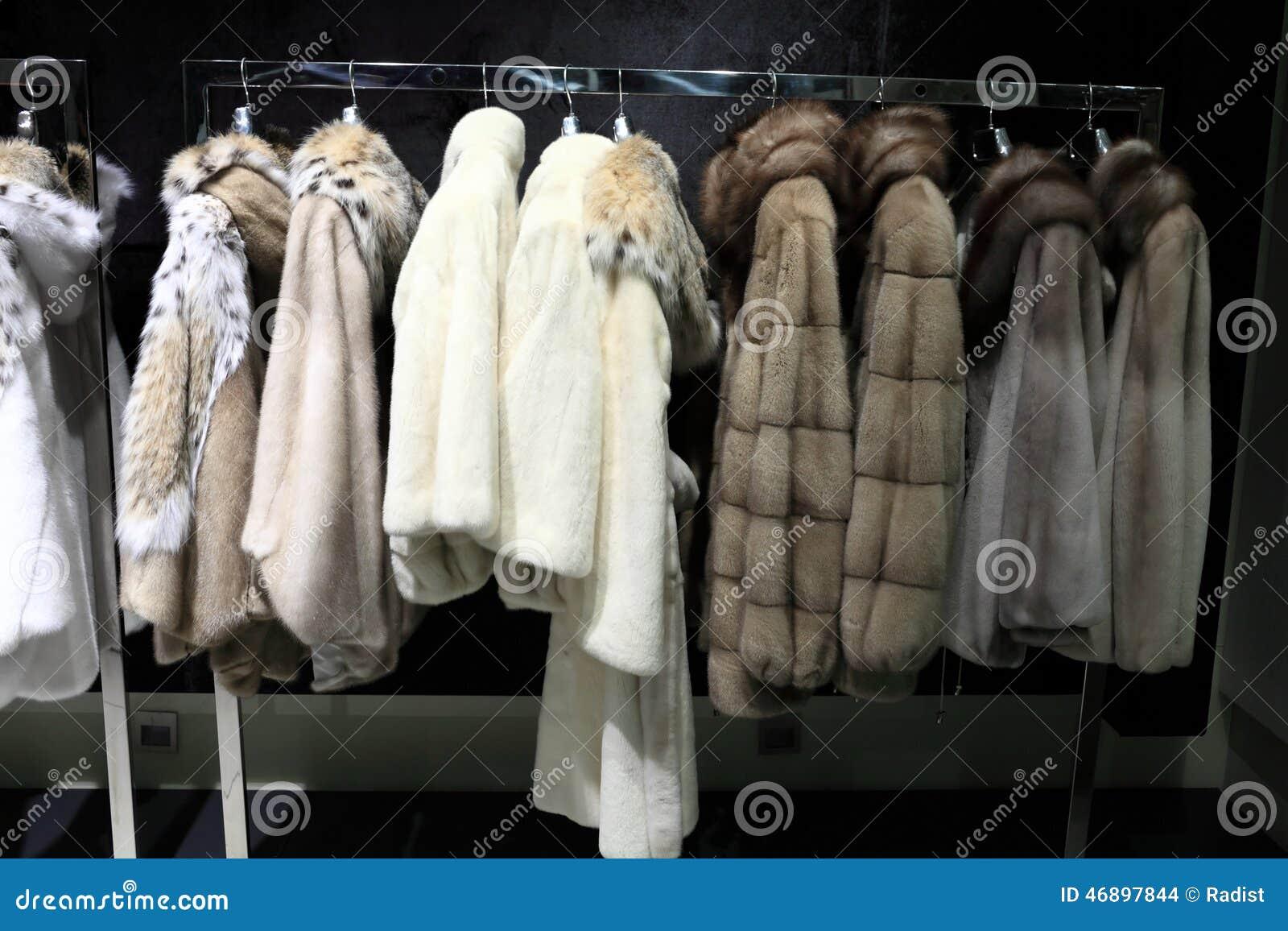 Fur coats on the hangers stock photo. Image of display - 46897844