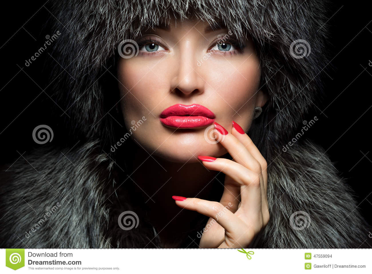 Fur Fashion. Beautiful Girl with red lips and manicure in Fur Ha