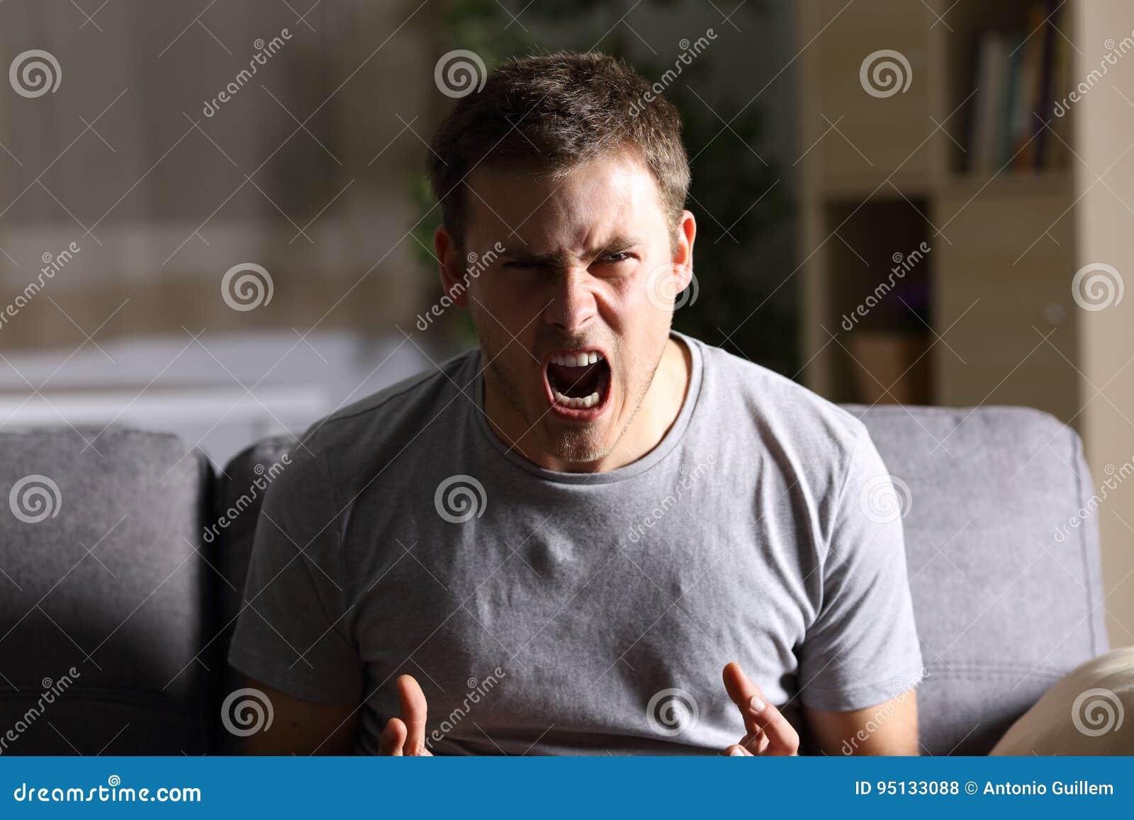 Furious man shouting at camera