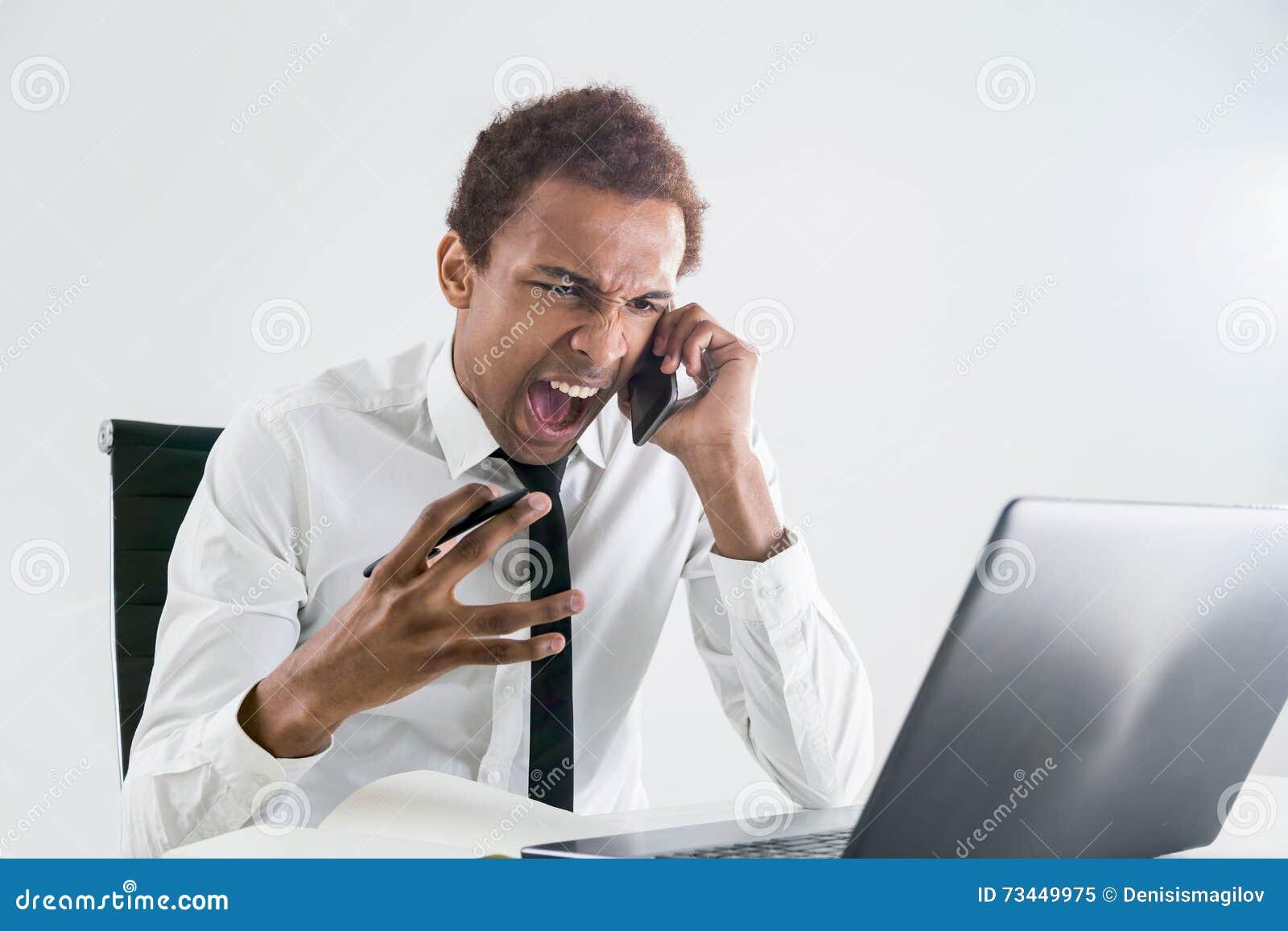 Furious man shouting on phone