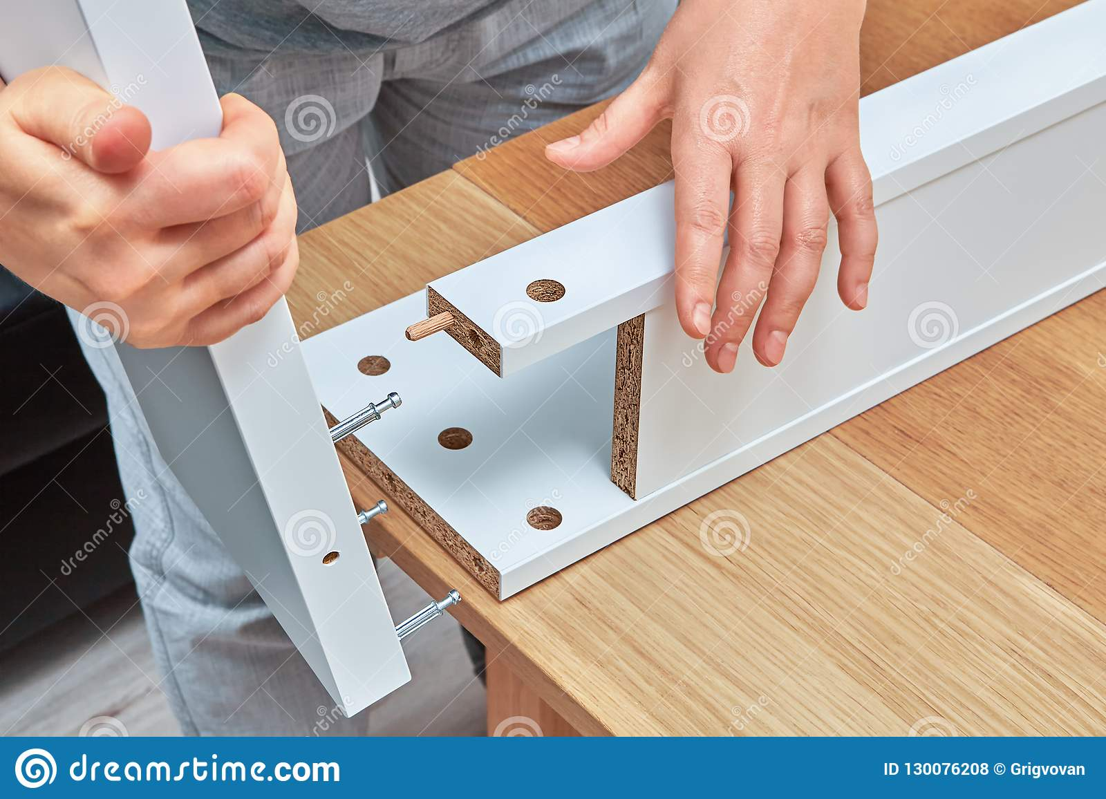 Furniture Assembler Connects Parts Of Table Furniture Assembly