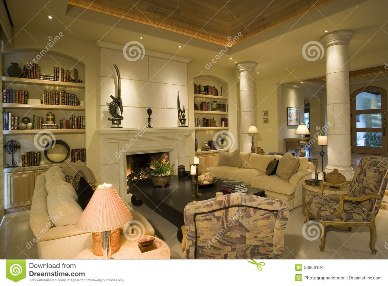 furniture at fireplace with bookshelves at home stock photo