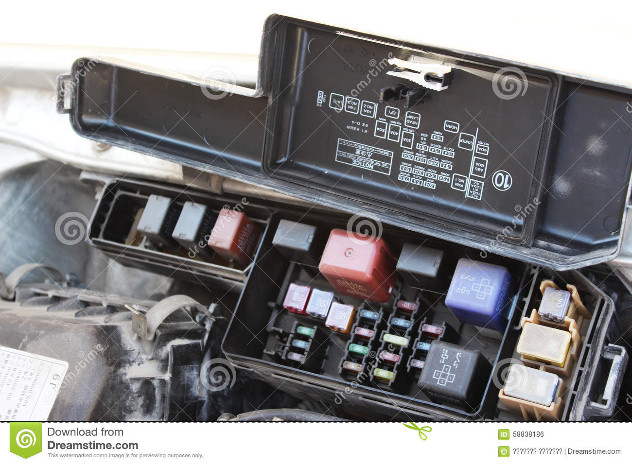 fuse box under hood car 58838186 the fuse box under the hood stock photo image 58838186 under the hood fuse box 1990 geo tracker at webbmarketing.co