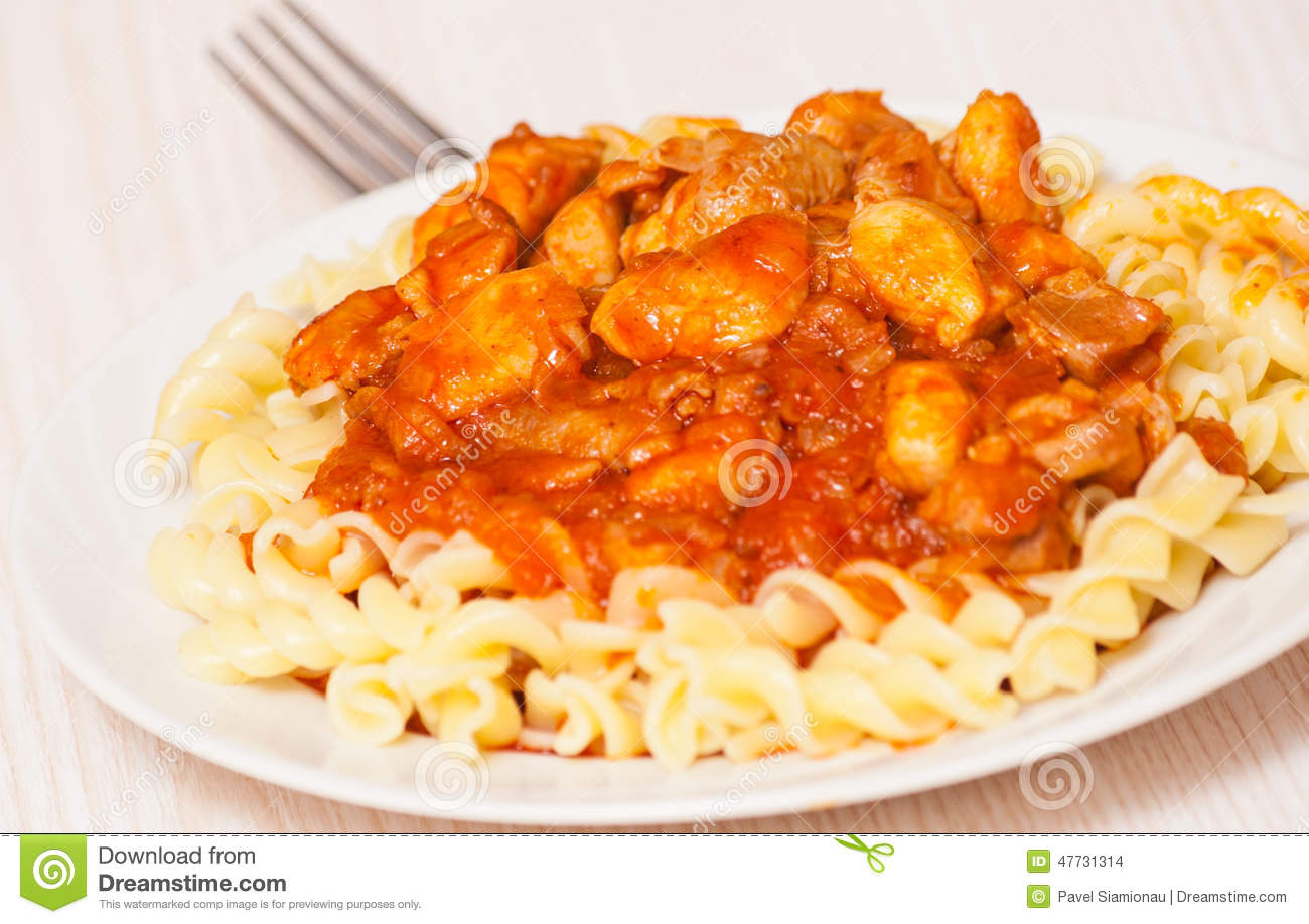 Fusilli Pasta With Chicken In Tomato Sauce Stock Photo ...