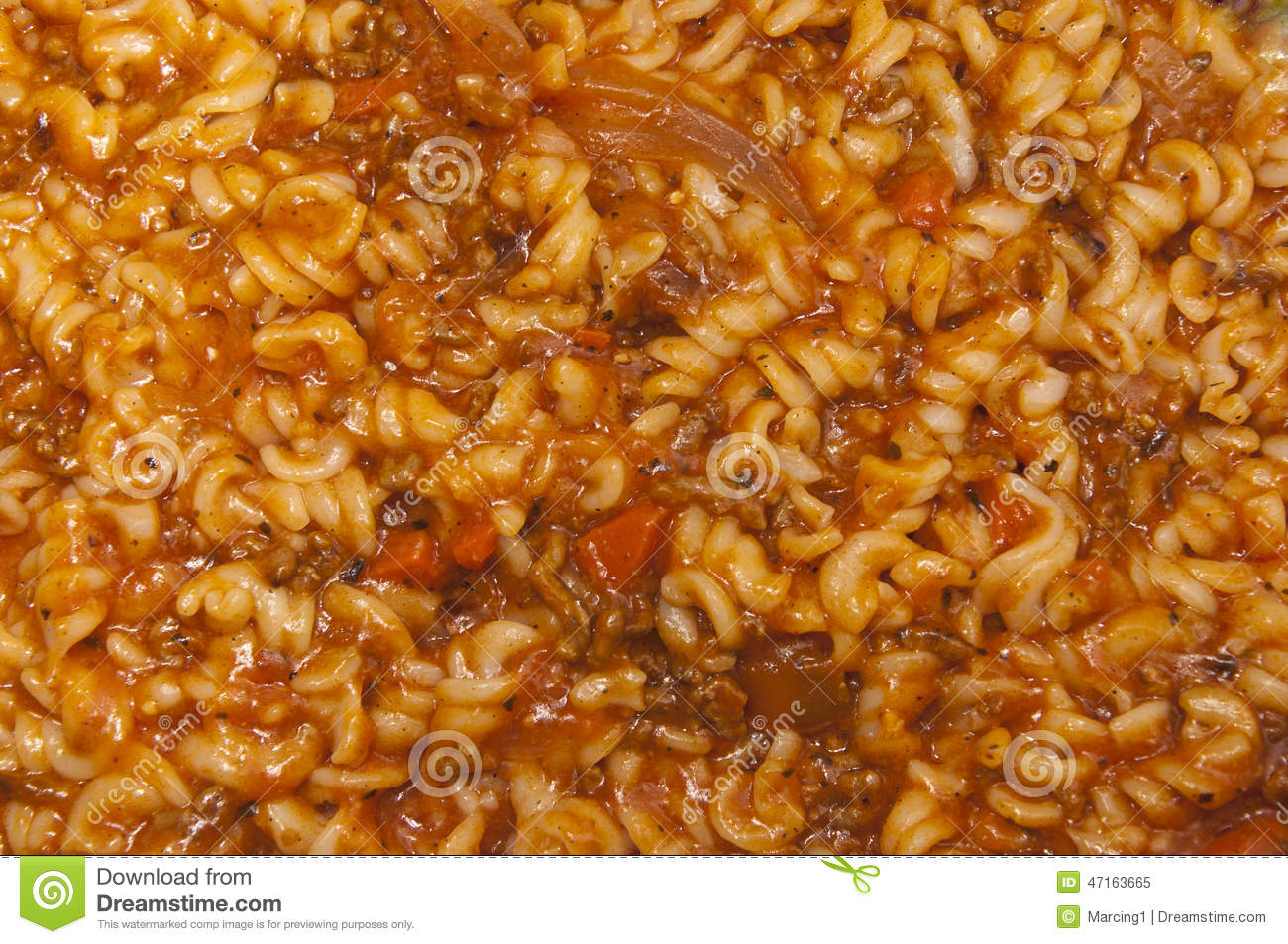 Closeup on a fusilli pasta with minced meat and tomato sauce with ...