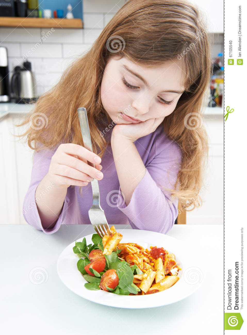 Fussy Girl With Healthy Meal At Home