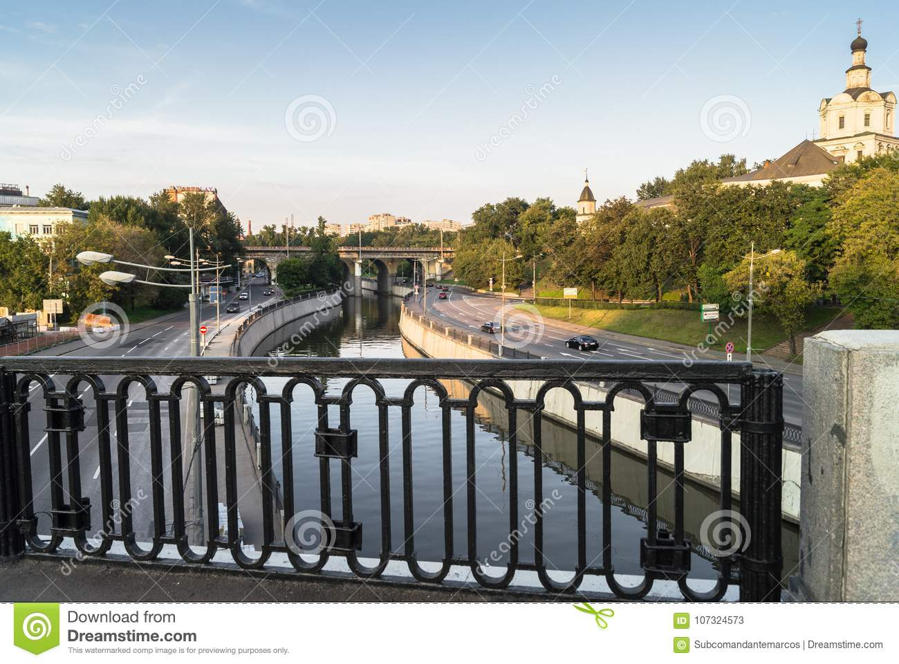 View of the river Yauza and roadway of its embankments from the Kostomarovsky bridge in sunset light, Moscow, Russia.