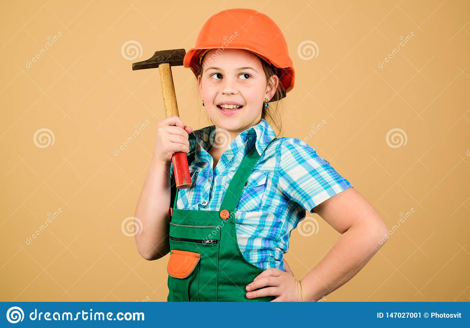 Future profession. Child care development. Builder engineer architect. Kid worker in hard hat. Tools to improve yourself