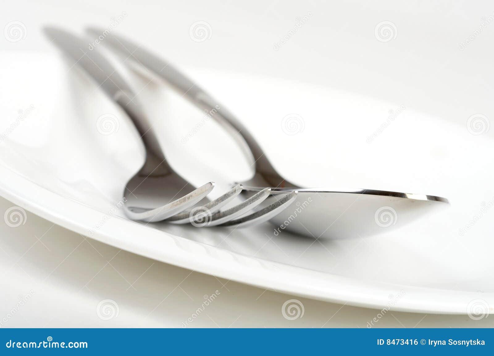 Gaffel och sked på plattan