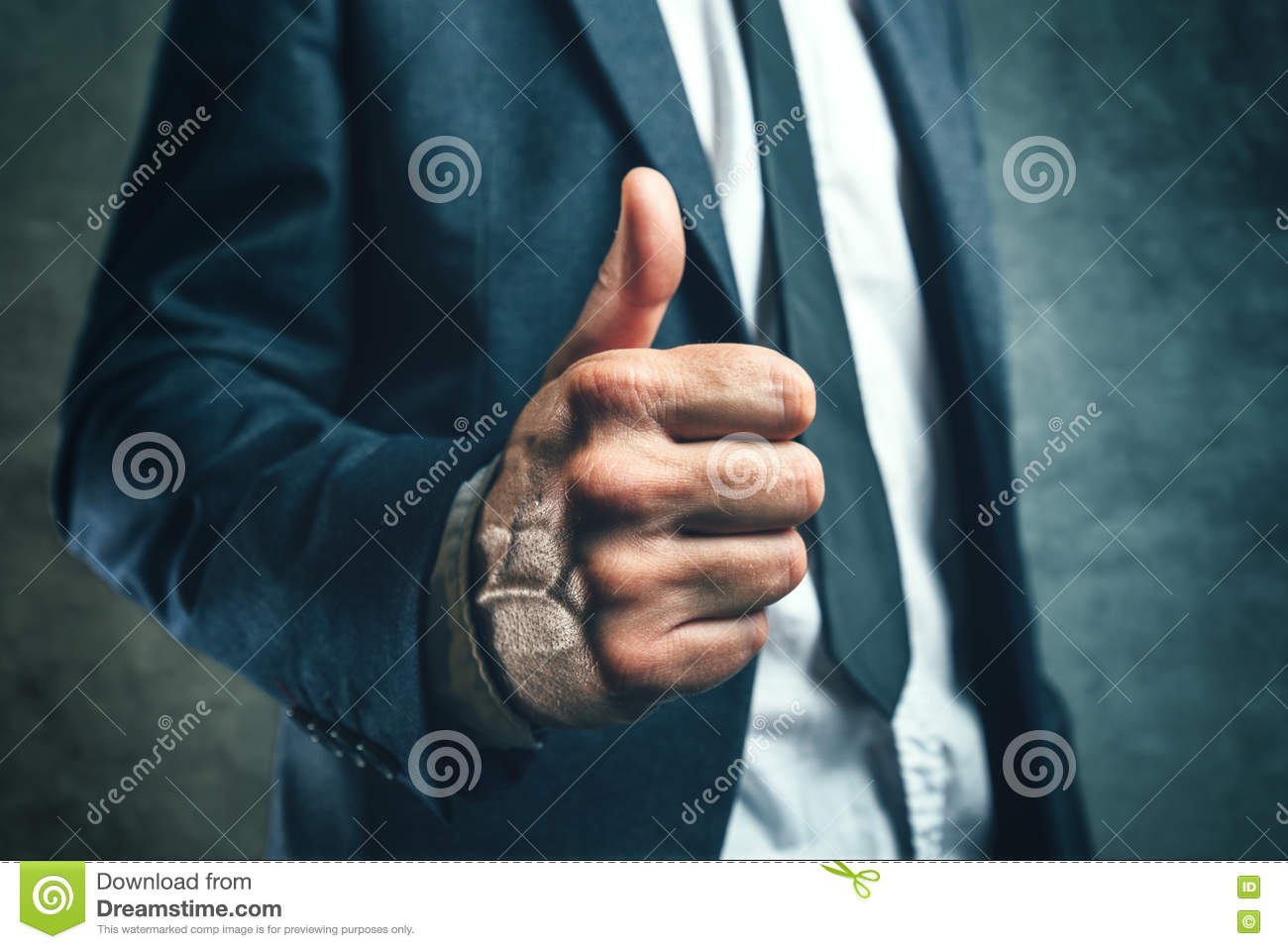 Gaining bosses approval, businessperson gesturing thumb up