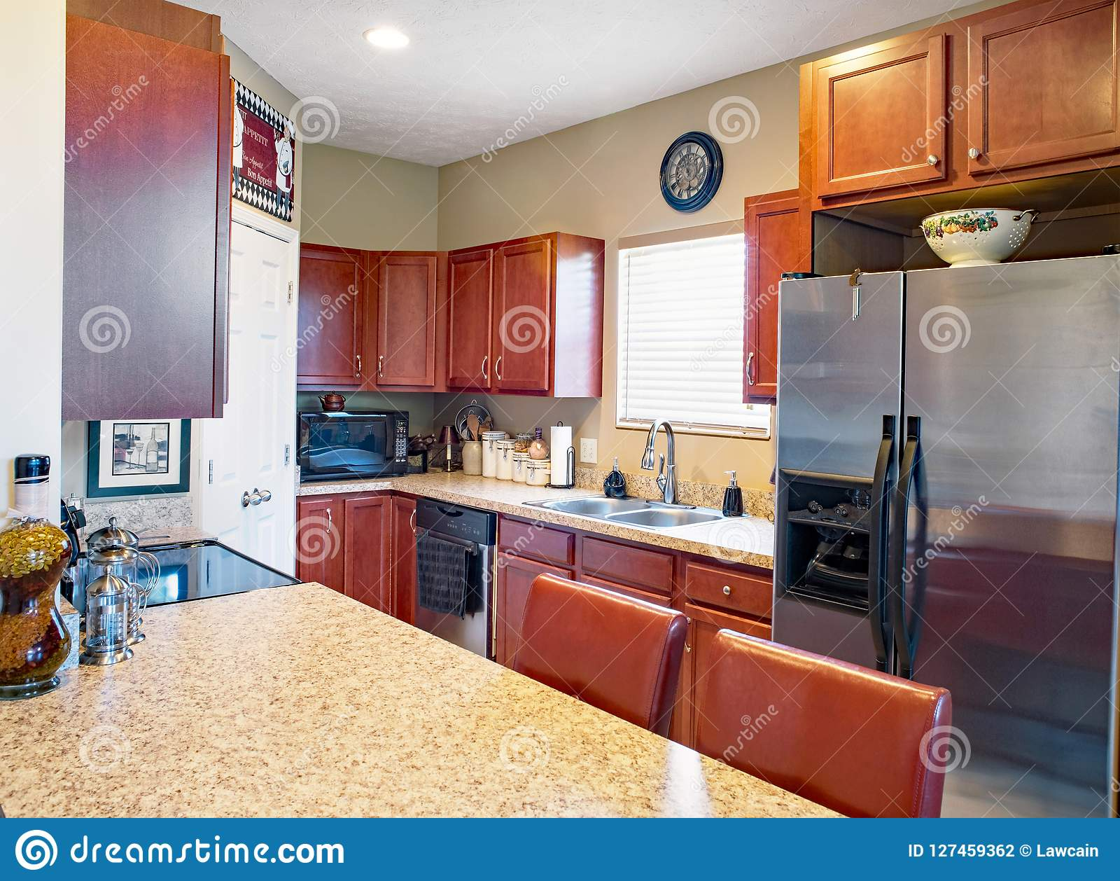 Galley Kitchen With Cherry Cabinets Editorial Photography ...