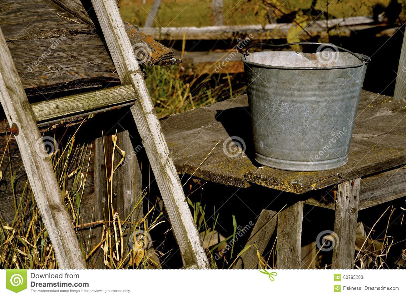 Galvanized pail rests on an old table
