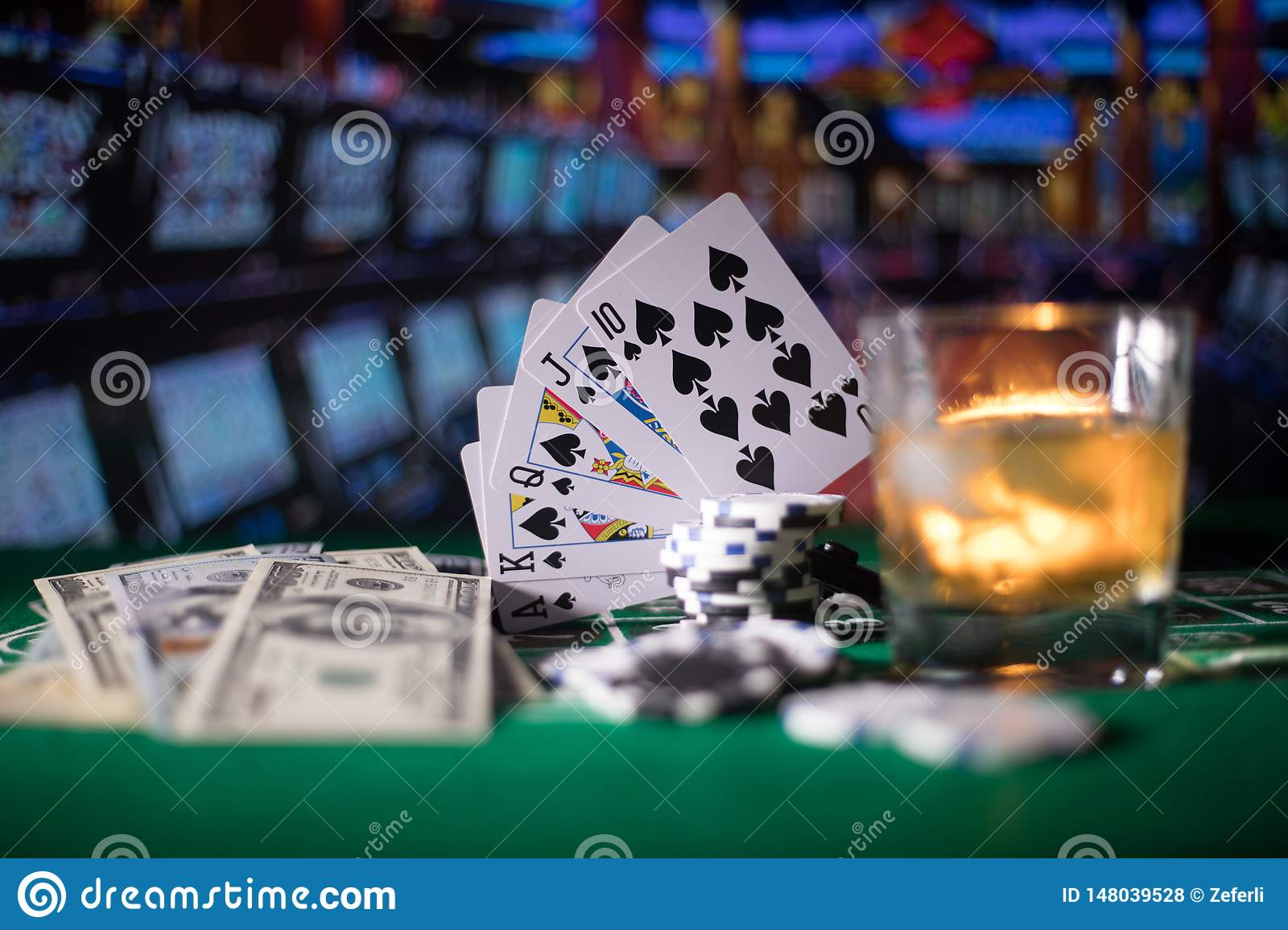 gambling, fortune, game and entertainment concept - close up of casino chips and whisky glass on table