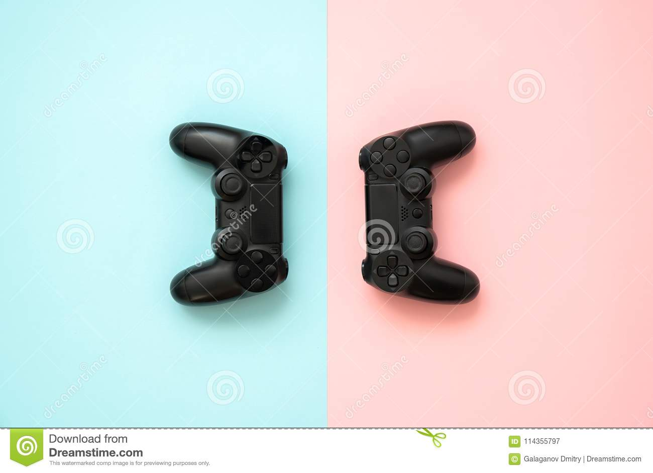 Game joystick console with electronics, accessories, pink and blue background.