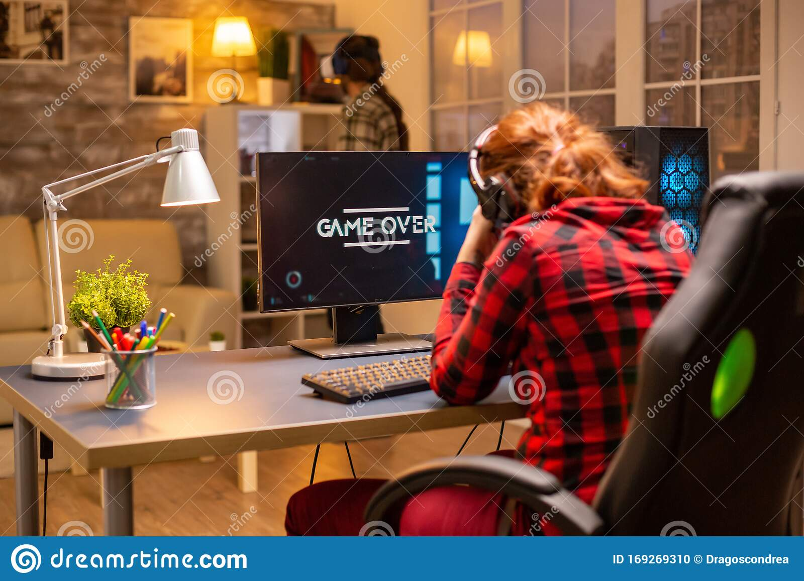 Woman playing online poker late at night Ladybug golden dragon slots