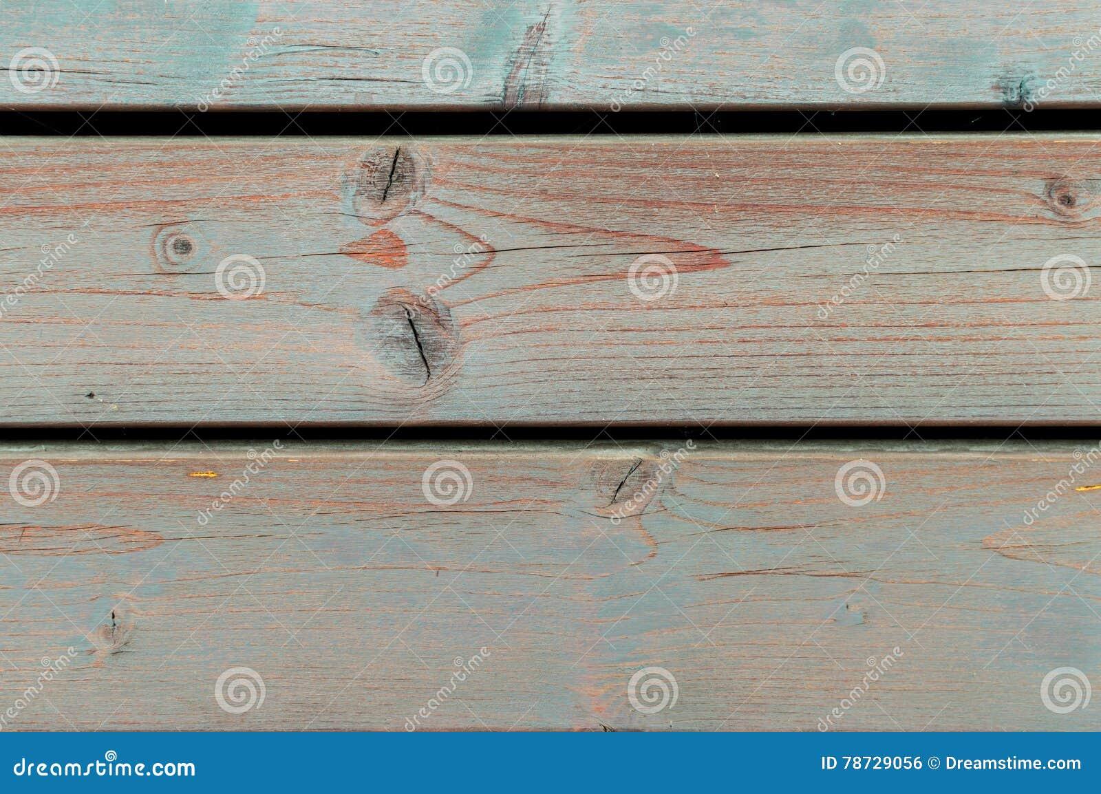 Gamla blått och orange träknarrat staket - wood texturbakgrund