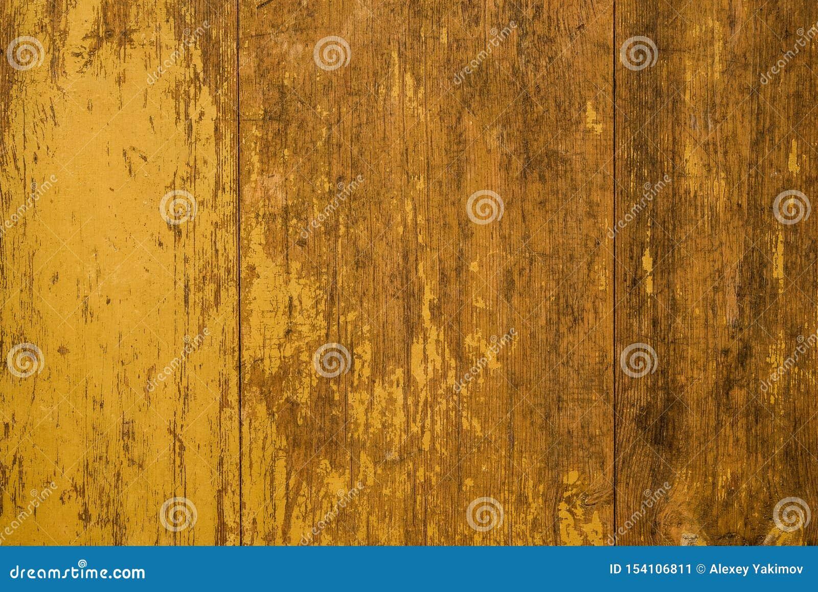 Gamla gula målade plankor för Grunge med trätextur